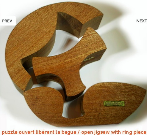 BOIS- concours Noces de bois Galerie E.Vanier 2009 - COSTANZA 'aupres de mon arbre-Naissance' -puzzle libérant la bague 2.jpg