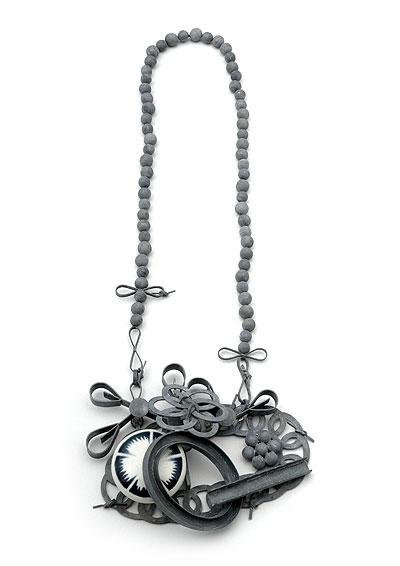 LUCY SARNEEL - necklace 'souvenir d'1 couvercle' 2007 - zinc, porcelain, nylon thread.jpg